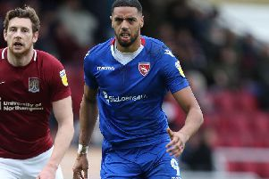 Vadaine Oliver was in the blue of Morecambe when the Shrimps played at Sixfields last season