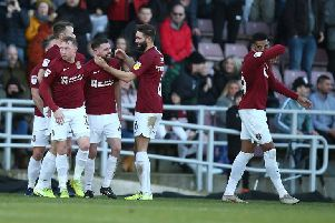 Paul Anderson takes the plaudits after scoring the opening goal for the Cobblers (Picture: Pete Norton)