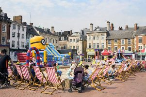 The giant sandpit is currently set up in Northampton's Market Square for little one's to use during six-weeks of no term time.