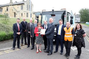 Representatives from FCC and East Northants Council with the new contract which only started this summer