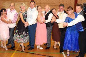 Five of the six dancers and their partners