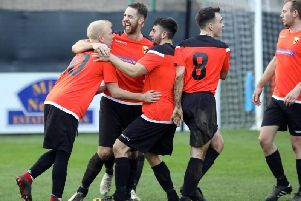 Rushden & Higham United celebrate their opening goal in the 2-0 victory over Thrapston Town in the third round of the NFA Junior Cup. Pictures by Alison Bagley