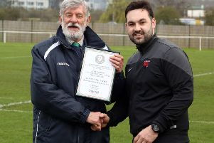 The United Counties League has been mourning the loss of chairman John Weeks, who is pictured presenting a manage of he month award to Whitworth manager James Mallows last year
