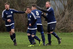 Kettering All Stars celebrate one of Leigh Chapman's three goals during their fine 8-0 success at Great Doddington in Division Four. Pictures by Alison Bagley