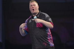 Ketterings Ricky Evans celebrates winning a leg during his first-round match against Rowby-John Rodriguez but Rapid was eventually knocked out of the William Hill World Darts Championship. Picture courtesy of Lawrence Lustig/PDC