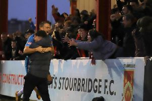 Brett Solkhon celebrates with the Kettering Town fans after he scored the equaliser in the crucial 2-1 success at title rivals Stourbridge. Pictures by Peter Short