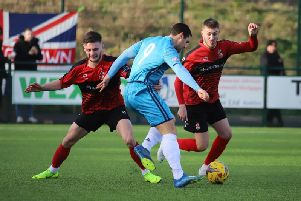 Dan Holman takes on two Redditch United defenders during Kettering Town's 4-1 victory. Picture by Peter Short