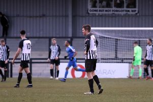 The Corby Town players look dejected after Dunstable Town scored the winner in their 2-1 success at Steel Park. Pictures by Alison Bagley