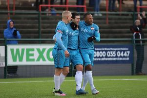 Dan Holman is congratulated by Lindon Meikle and Aaron O'Connor after he scored Kettering Town's third goal in the 4-1 success at Redditch United. Picture by Peter Short