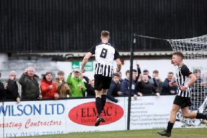 Connor Kennedy jumps for joy after scoring Corby Town's third goal in the 3-2 victory over Didcot Town at Steel Park. Pictures by Alison Bagley