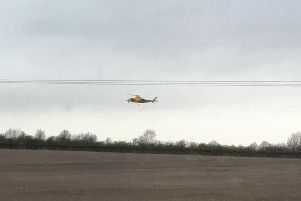 The Air Ambulance coming into land near the scene