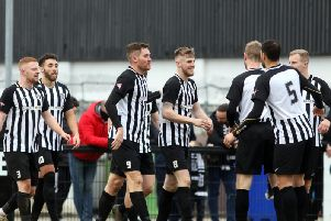 Connor Kennedy was all smiles after scoring the third goal in the Steelmens win over Didcot. But he is now facing a three-match ban after being sent-off late in the game