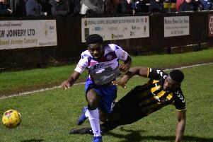 Substitute Ben Acquaye is tackled during AFC Rushden & Diamonds 2-0 defeat at Rushall Olympic on Monday night. Picture courtesy of HawkinsImages