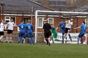 Goalmouth action from Desborough Town's 2-0 home defeat to leaders Daventry Town in the UCL Premier Division last weekend. Pictures by Alison Bagley