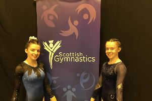Kettering Olympic Gymnastics Club members Naomi Wright (left) and Kallie Walker returned from the Scottish National Championships with a bronze and gold medal respectively