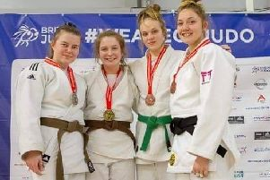 Karis Haughton-Brown, of Vale Judo Club, on the podium with her gold medal and the other top competitors, as she won in the under 70kg at the British Schools Judo Championship