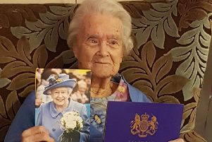 Betty with her card from the Queen.