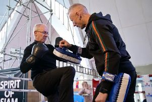 The Archbishop of Canterbury with thai boxing trainer Lee Wills