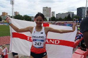 Emily Williams flies the flag after she was crowned ISF 800m World Schools champion in Croatia