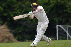 Greig Hofbauer hits out on his way to an unbeaten 114 during Finedon Dolben's win at Horton House. Pictures by Dave Ikin
