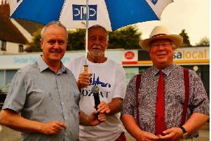 Leader of Wellingborough Council, Martin Griffiths, Chairman of Bozeat Parish Council, Brian Gibbins and Deputy Leader of the Council, Tom Partridge-Underwood at Bozeat Fete, following the handing over of a �1 for the transfer of the village green. 'Saturday 6th July 2019 NNL-190907-145929005