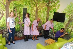 From left, therapeutic activities co-ordinator Joanna Momi, healthcare assistants Kelly Freeman, Lydia Tucker and Donna Deacon, and housekeeper Camilo Quesada showing the new murals in the Naseby day room at Kettering General Hospital.