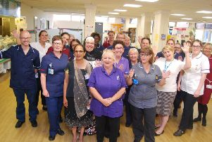 Members of Kettering General Hospitals clinical, housekeeping and infection prevention and control teams celebrate the MRSA bacteraemia free achievement at a daily safety meeting.