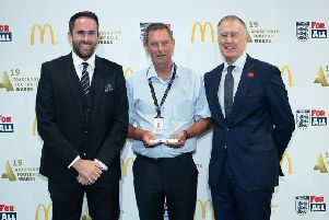 McDonald's Grounds Team of the Year Winner Karl Standley, Tony Sanders with Sir Geoff Hurst.