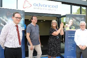 Head of property at Corby Council Jonathan Waterworth (left) and council leader Tom Beattie with Advanced Chain Supply bosses last month.