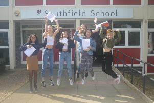 Pupils jump for joy at their results.