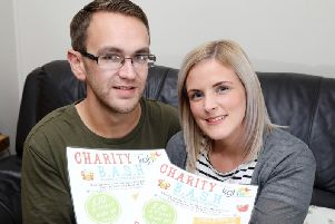 Chloe and Chris Turner with their charity bash flyer.