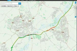 A black line of stationary traffic on the A45 by Wellingborough