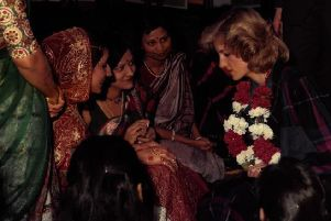 Members of the community showed Princess Diana the art of henna hand decoration