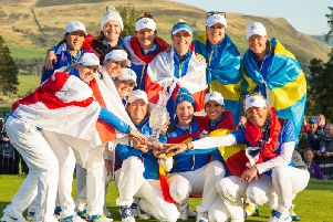 Burton Latimer's Charley Hull (back row, centre) and her Europe team-mates show their delight after they beat the USA to win the Solheim Cup. Picture courtesy of Tristan Jones