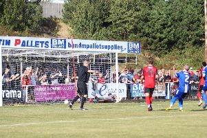Dan Nti scores from the penalty spot during Kettering Town's 1-1 draw with Sutton Coldfield Town at Latimer Park. Pictures by Peter Short