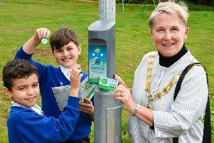 Children from Kettering Park Junior Academy with Mayor Keli Watts scanning their Beat the Street cards and fobs at a Beat box
