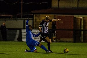 Joint-manager Gary Mulligan in action during Corby Town's 2-1 success over Barton Rovers on Wednesday night. Picture by Jim Darrah