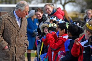 Prince Charles chats to pupils from Highlees Primary School, Peterborough who greeted him on his visit to Tattershall Castle in Lincolnshire. Picture: John Aron.