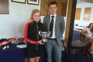 Emily Horsted received her Milton Junior Open prize from Richard Berry.