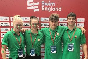 Deepings' swimmers Holly Leggott, Bethany Eagle-Brown, Louis Metselaar and Tom Neal in the green of Lincolnshire at the National County Team Championships
