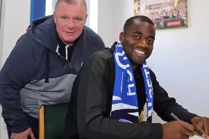 Sebastien Bassong with Peterborough United manager Steve Evans