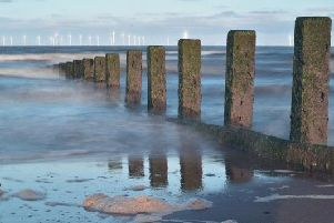 The report warns that England's coast will see a sea level rise of at least one metre at some point in the future