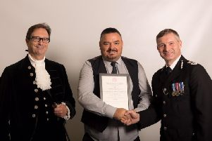 Darren Peace, (centre) receiving his award from from the High Sheriff of Lincolnshire (left) and the Chief Constable of Lincolnshire Police (right)