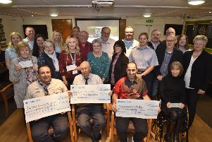 Deeping raft race cheque recipiants with raft race committee members at the presentation at Deeping Rugby Club. EMN-181029-231136009
