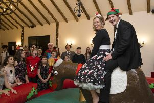 Charlotte and Daniel Peart help put on a party for the young carers. Copyright: Camelot