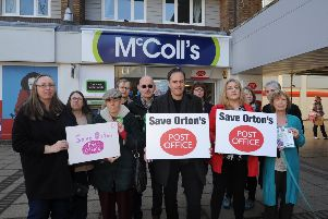 Cllr Julie Howell (front, second from right) demonstrating against the proposed loss of the Post Office at McColl's last year