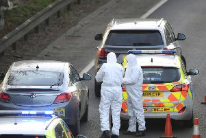 Police at the scene of the arrests on the A47 on Wednesday. Photo: Joe Giddens/PA