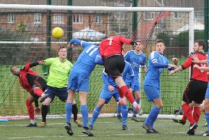 Action from Whittlesey's recent win at Netherton (red) n the Peterborough Senior Cup.