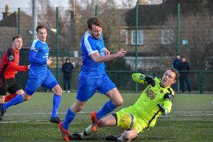 Action from Netherton's 2-2 draw with Whittlesey Athletic (blue) last weekend. Photo: James Richardson.