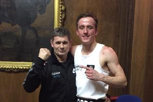 Peterborough Police boxer Ryan Davies  pictured with club coach Paul Goode.